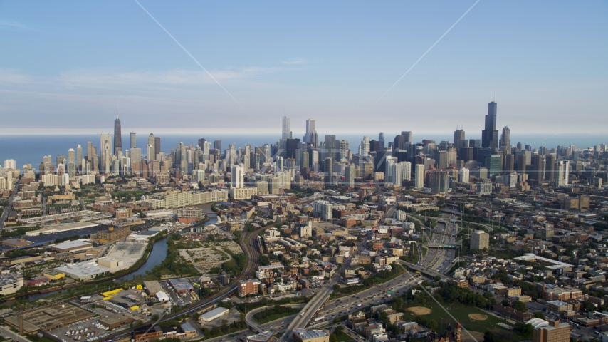 The Downtown Chicago skyline seen from the west, on a hazy day, Illinois Aerial Stock Photo AX0001_063.0000122F | Axiom Images