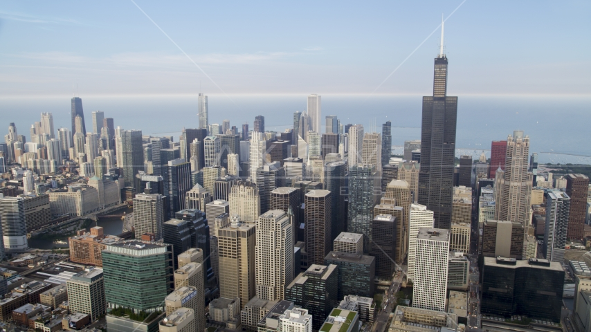 A view across Downtown Chicago on a hazy day, from Willis Tower to John Hancock Center, Illinois Aerial Stock Photos | AX0001_069.0000169F