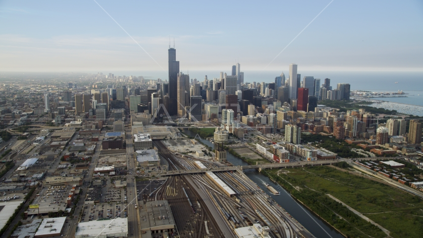 Train yards by the Chicago River near the downtown skyline on a hazy day, Downtown Chicago, Illinois Aerial Stock Photo AX0001_076.0000284F | Axiom Images