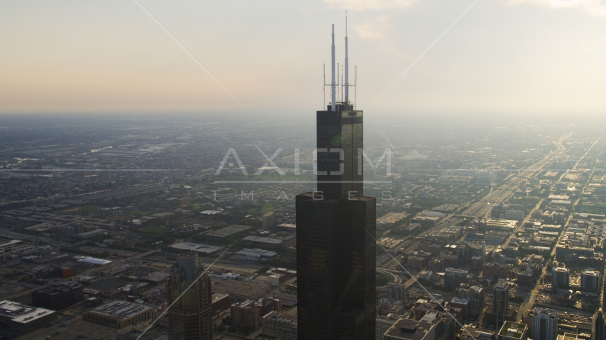 The top of the iconic Willis Tower on a hazy day, Downtown Chicago, Illinois Aerial Stock Photos | AX0001_083.0000121F