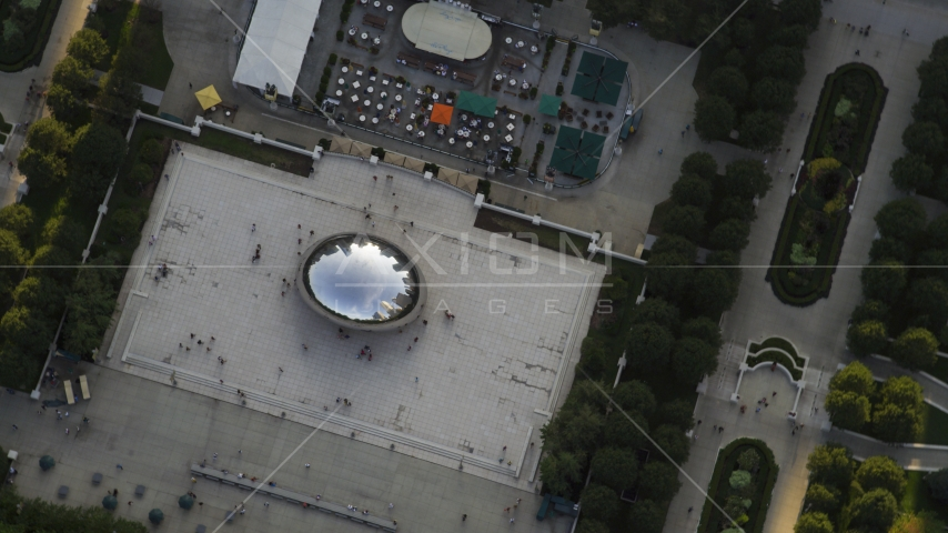 A bird's eye view of Cloud Gate sculpture at AT&T Plaza in Grant Park, Downtown Chicago, Illinois Aerial Stock Photos | AX0001_105.0000109F