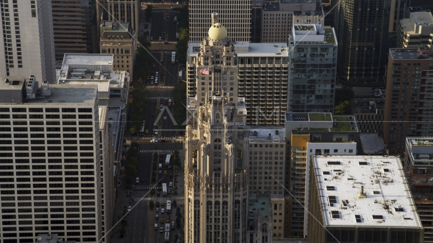 A flag flying at top of Tribune Tower in Downtown Chicago, Illinois Aerial Stock Photos | AX0001_118.0000016F