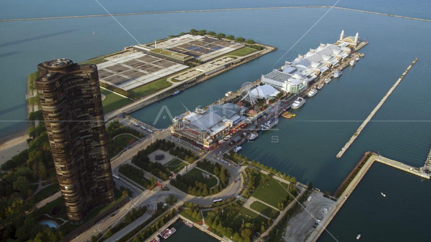 A view of Navy Pier on Lake Michigan, seen from Downtown Chicago, Illinois Aerial Stock Photos | AX0001_120.0000347F