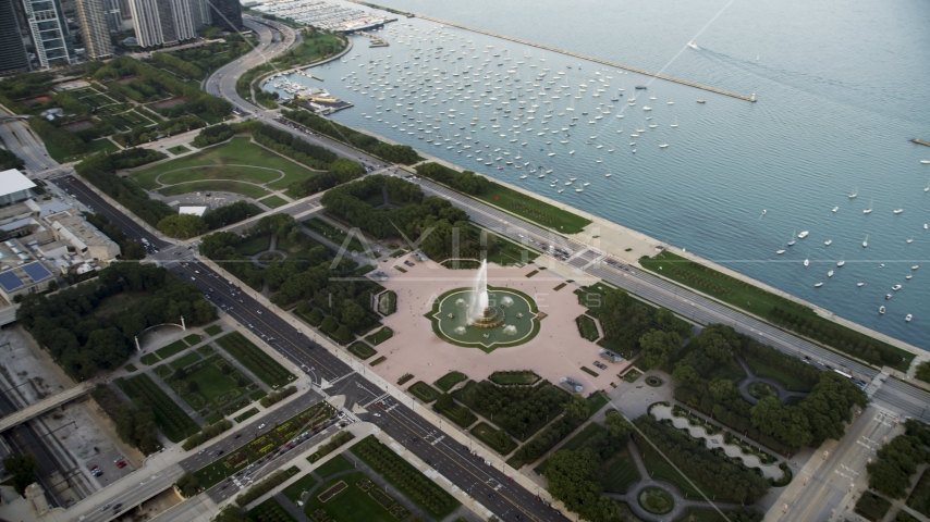 The Buckingham Fountain in Grant Park near boats in the harbor, Downtown Chicago, Illinois Aerial Stock Photos | AX0001_151.0000000F