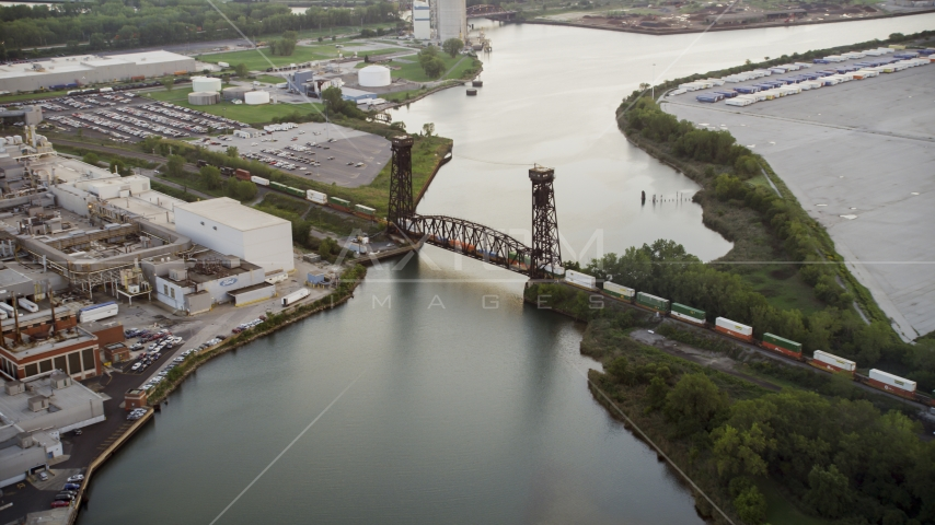 A train crossing a bridge spanning the Calumet River in Hegewisch, Chicago, Illinois Aerial Stock Photo AX0001_171.0000135F | Axiom Images