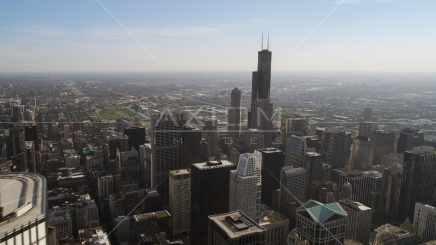 A view of Willis Tower from across Downtown Chicago, Illinois Aerial Stock Photos | AX0002_027.0000419F