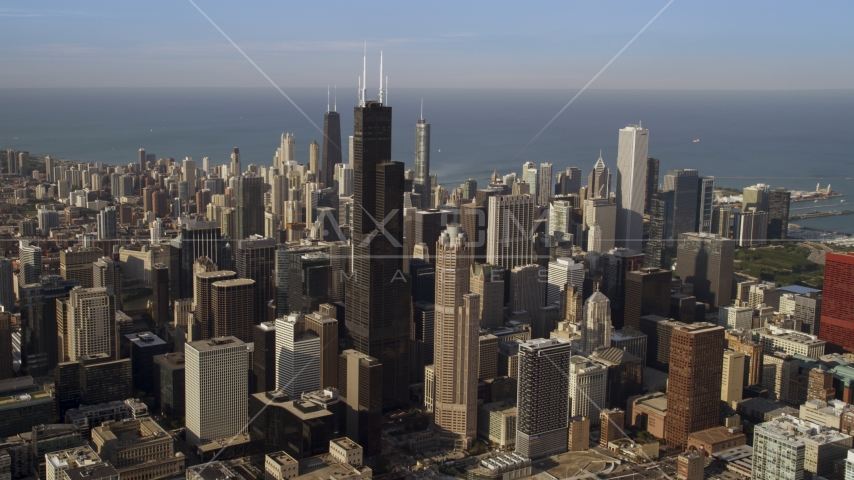 Downtown Chicago cityscape and the iconic Willis Tower skyscraper, Illinois Aerial Stock Photo AX0002_064.0000209F | Axiom Images