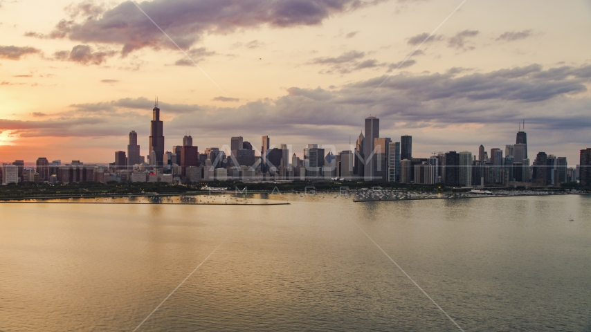 The Downtown Chicago skyline at sunset seen from Lake Michigan, Illinois Aerial Stock Photo AX0003_030.0000193F | Axiom Images