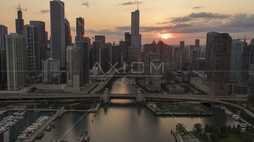 The bridge at mouth of Chicago River near downtown buildings at sunset, Downtown Chicago, Illinois Aerial Stock Photo AX0003_035.0000000F | Axiom Images