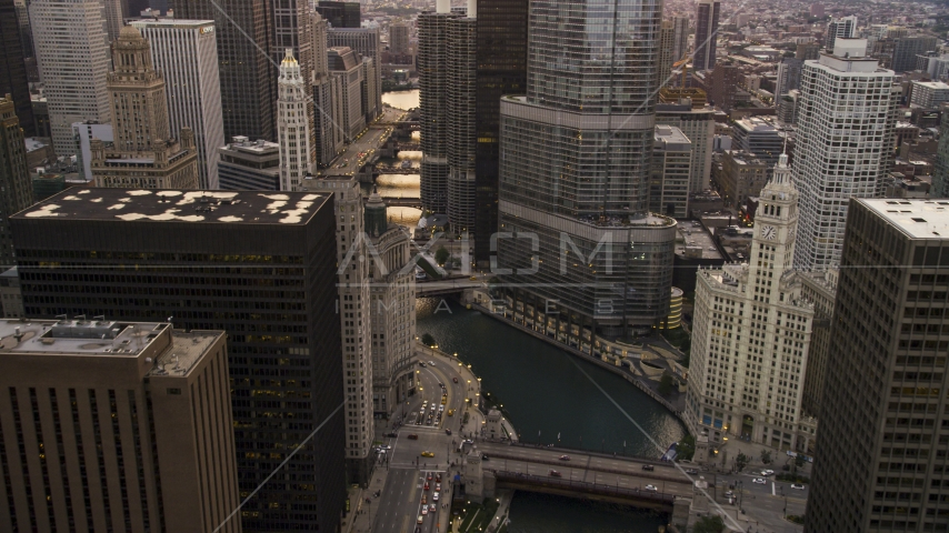 The Chicago River and the base of Trump Tower at sunset, Downtown Chicago, Illinois Aerial Stock Photo AX0003_037.0000286F | Axiom Images
