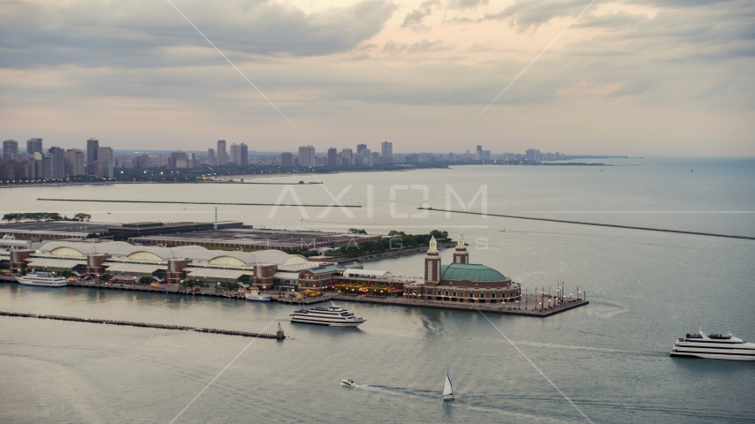 Two ferries by the end of the Navy Pier on a cloudy day at sunset, Chicago, Illinois Aerial Stock Photos | AX0003_063.0000418F