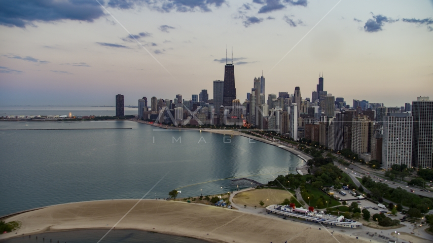 The skyline of Downtown Chicago seen from North Avenue Beach at twilight, Illinois Aerial Stock Photos | AX0003_073.0000132F