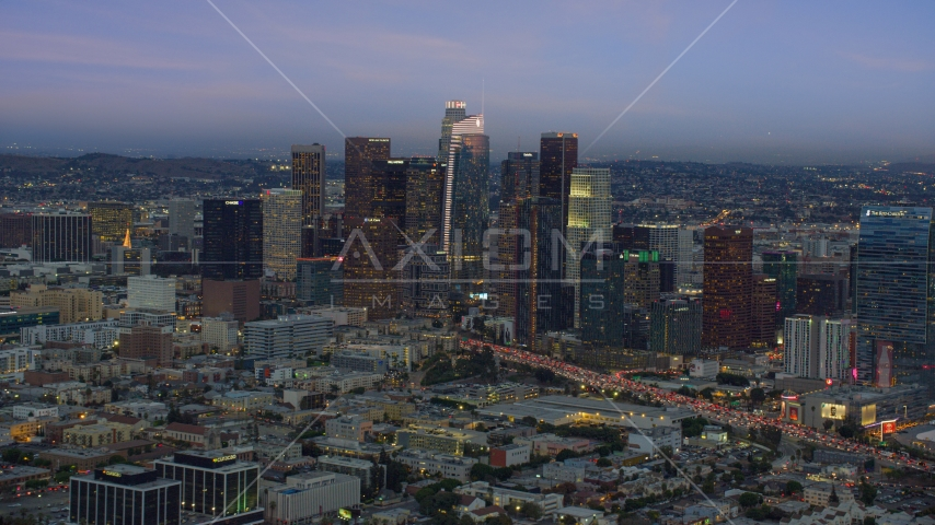 Downtown Los Angeles skyline with new skyscraper, Wilshire Grand Center, twilight, California Aerial Stock Photos | AX0158_044.0000179