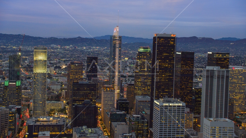 Wilshire Grand Center and nearby skyscrapers at twilight in Downtown Los Angeles, California Aerial Stock Photos | AX0158_047.0000110