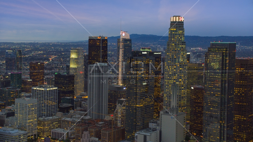 A group of skyscrapers at twilight in Downtown Los Angeles, California Aerial Stock Photos | AX0158_048.0000259