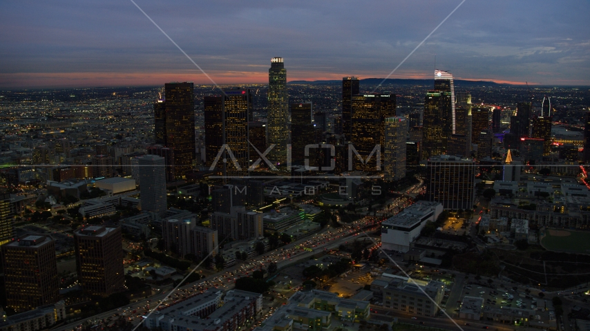 Tall skyscrapers at twilight in Downtown Los Angeles, California Aerial Stock Photos | AX0158_051.0000214