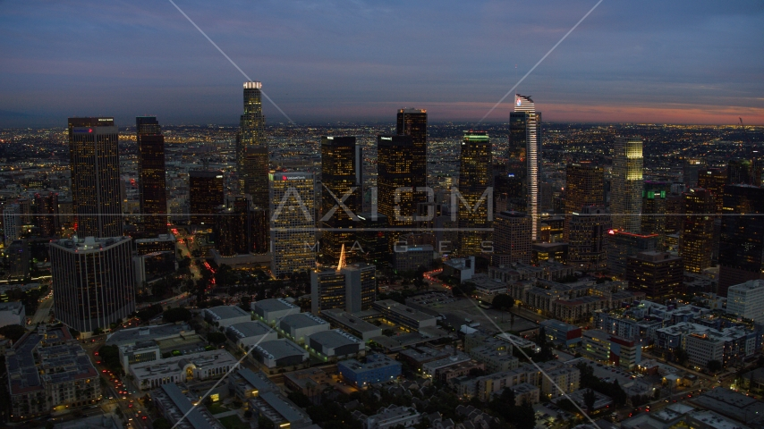 A view of skyscrapers at twilight in Downtown Los Angeles, California Aerial Stock Photos | AX0158_052.0000310