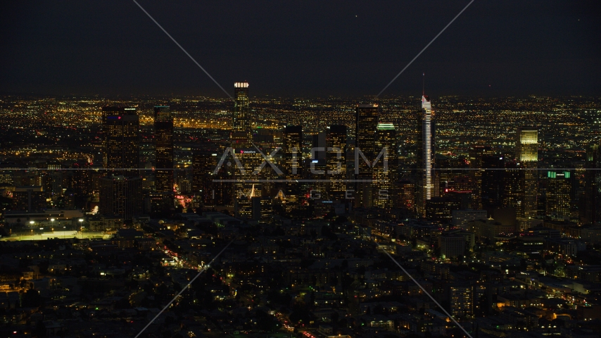 The Downtown Los Angeles skyline at night, California Aerial Stock Photos | AX0158_073.0000309