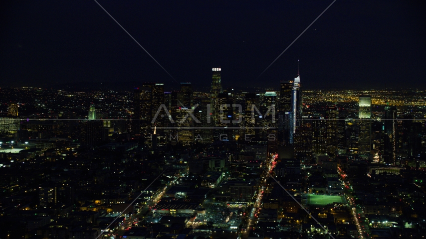 Towering skyscrapers of the city's skyline at night in Downtown Los Angeles, California Aerial Stock Photo AX0158_085.0000268 | Axiom Images