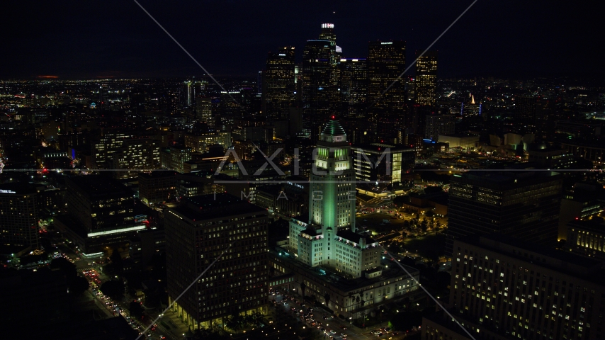 City Hall and the city's skyscrapers at night in Downtown Los Angeles, California Aerial Stock Photos | AX0158_103.0000016