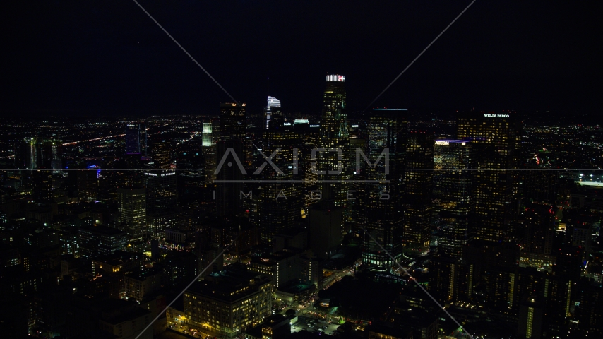 Tall city skyscrapers at night in Downtown Los Angeles, California Aerial Stock Photos | AX0158_110.0000136