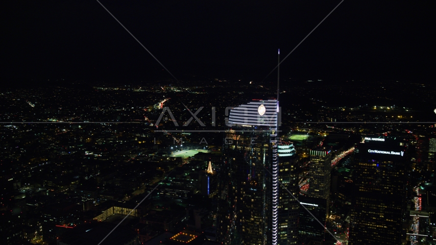 Wilshire Grand Center at night in Downtown Los Angeles, California Aerial Stock Photos | AX0158_112.0000288