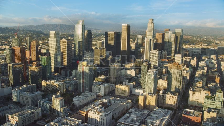 A view of tall skyscrapers in Downtown Los Angeles, California Aerial Stock Photos | AX0162_007.0000399