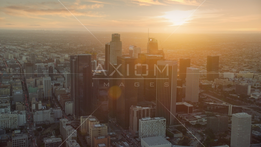 The tall towers of downtown at sunset in Downtown Los Angeles, California Aerial Stock Photos | AX0162_086.0000142