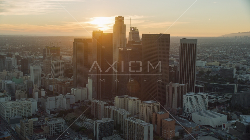 Tall city skyscrapers of downtown at sunset in Downtown Los Angeles, California Aerial Stock Photos | AX0162_088.0000000