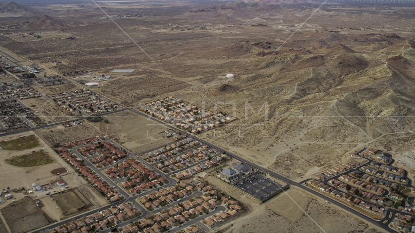 A view of desert residential neighborhoods in Rosamond, California Aerial Stock Photo AX06_100.0000180 | Axiom Images