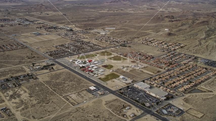 Homes in desert neighborhoods in Rosamond, California Aerial Stock Photos | AX06_101.0000167