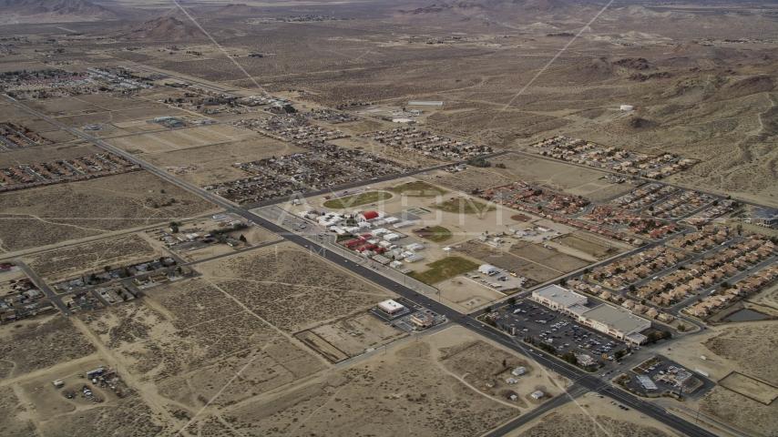 Neighborhoods in a desert town in Rosamond, California Aerial Stock Photos | AX06_101.0000199