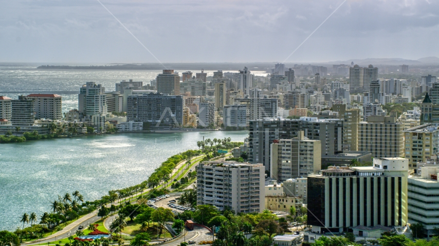 Waterfront Apartment Buildings in the rain, San Juan Puerto Rico Aerial Stock Photos | AX101_003.0000000F