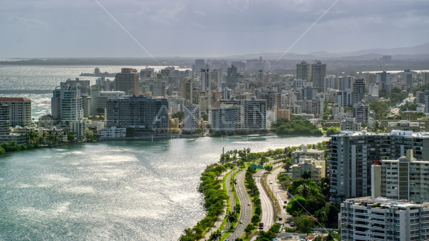 Waterfront apartment buildings and rain, San Juan, Puerto Rico Aerial Stock Photos | AX101_003.0000154F