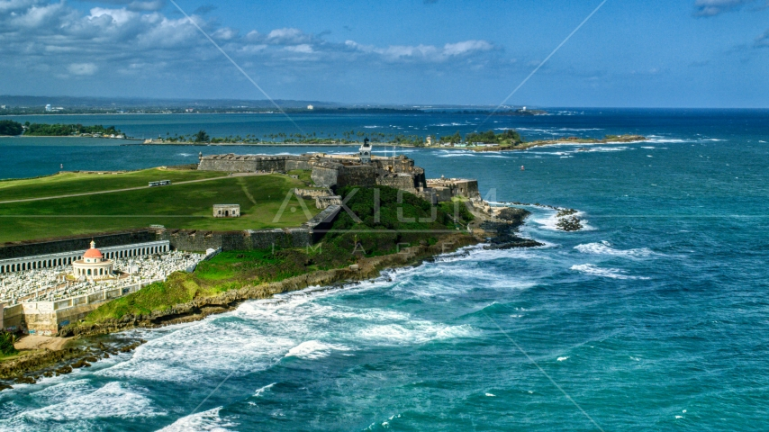 Historic fort on the coast by clear blue water, Old San Juan, Puerto Rico Aerial Stock Photo AX101_011.0000000F | Axiom Images