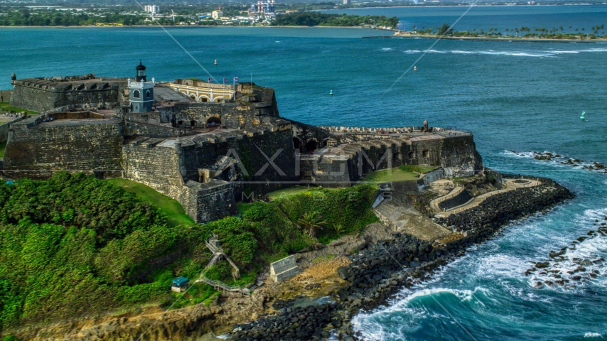 Historic fort along the coast with clear blue water, Old San Juan Puerto Rico Aerial Stock Photo AX101_012.0000125F | Axiom Images