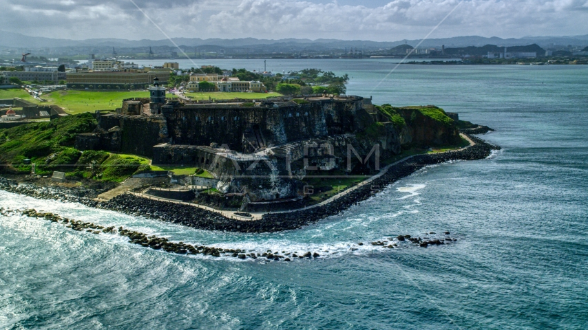 Historic fort along the coast of clear blue water, Old San Juan Puerto Rico Aerial Stock Photo AX101_013.0000148F | Axiom Images