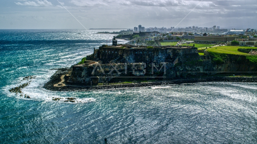Historic fort on the coast with clear blue water, Old San Juan, Puerto Rico Aerial Stock Photo AX101_015.0000000F | Axiom Images