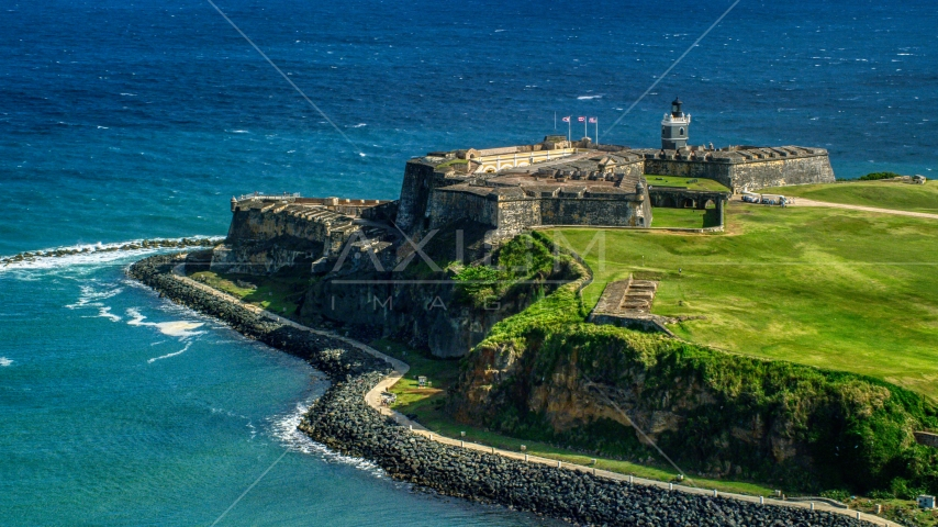 The seaside Fort San Felipe del Morro in Old San Juan, Puerto Rico Aerial Stock Photo AX101_017.0000136F | Axiom Images