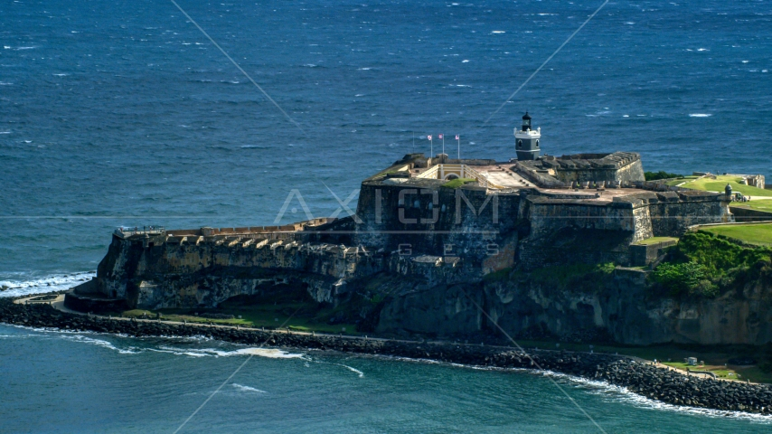 Historic fort on the coast in the blue Caribbean waters, Old San Juan Puerto Rico Aerial Stock Photo AX101_020.0000163F | Axiom Images