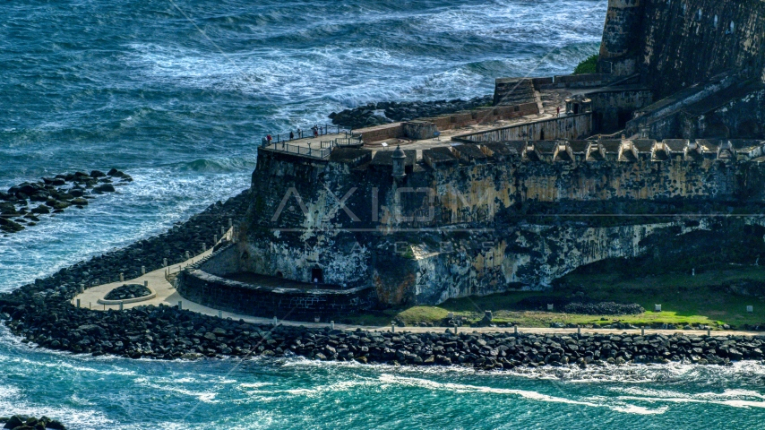 Historic Caribbean fort with tourists, Old San Juan, Puerto Rico Aerial Stock Photo AX101_021.0000232F | Axiom Images