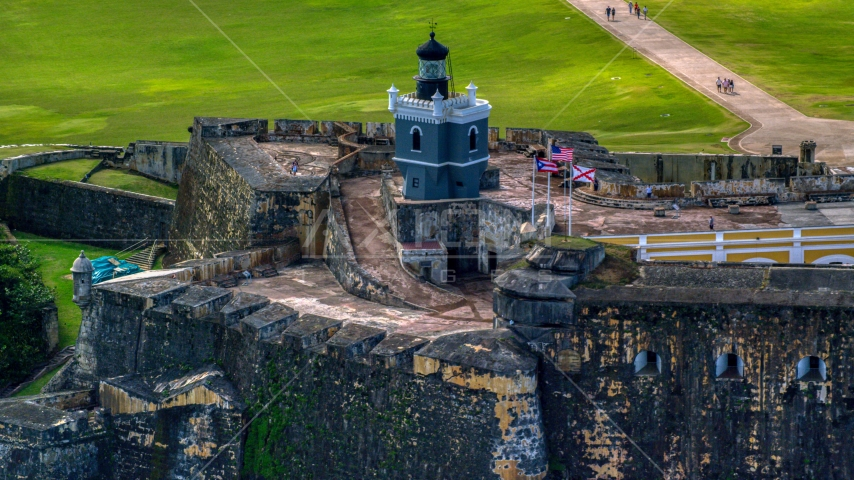 Historic Caribbean fort and lighthouse, Old San Juan, Puerto Rico Aerial Stock Photos | AX101_023.0000208F
