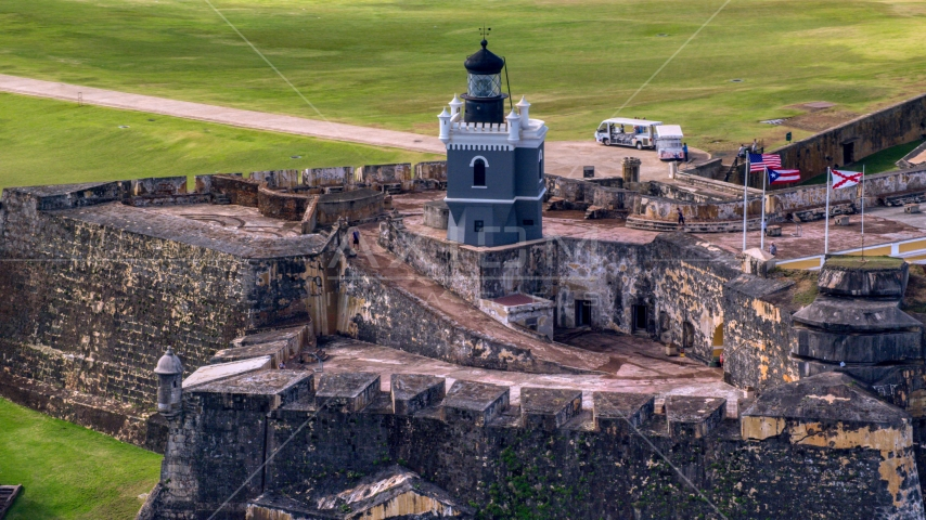 Historic fort and lighthouse, Old San Juan Puerto Rico Aerial Stock Photo AX101_024.0000203F | Axiom Images