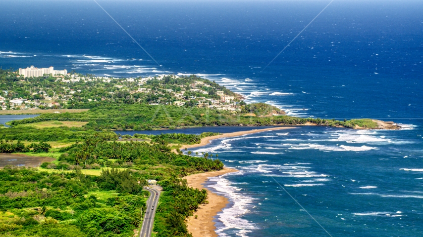 Resort town by the beach and blue Caribbean coastal waters, Dorado, Puerto Rico Aerial Stock Photos | AX101_031.0000000F