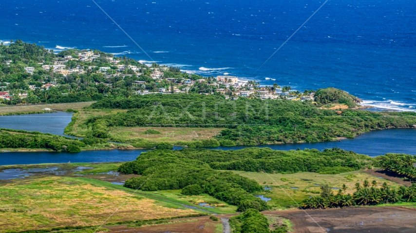 Resort town along the blue Caribbean coastal waters, Dorado, Puerto Rico Aerial Stock Photos | AX101_032.0000227F