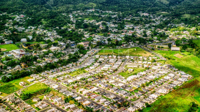 Neighborhood in a small town, Morovis, Puerto Rico  Aerial Stock Photo AX101_044.0000172F | Axiom Images