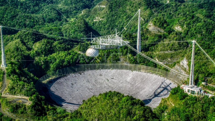 Arecibo Observatory nestled in the lush green forest, Puerto Rico  Aerial Stock Photo AX101_092.0000000F | Axiom Images