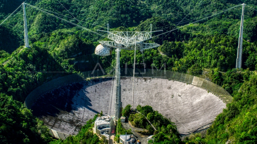 Arecibo Observatory in lush green Karst forest, Puerto Rico Aerial Stock Photos | AX101_093.0000000F