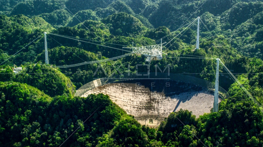 Arecibo Observatory in lush green Karst forest, Puerto Rico  Aerial Stock Photo AX101_096.0000000F | Axiom Images