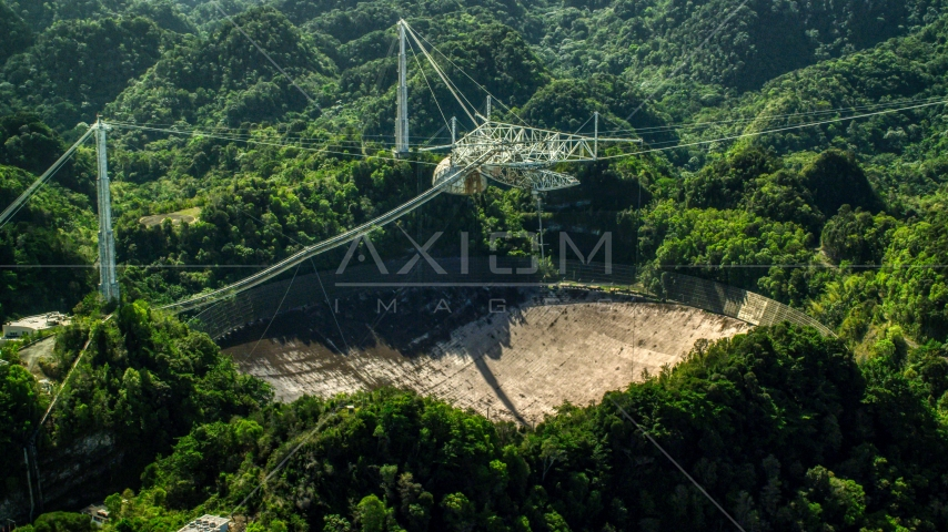 Arecibo Observatory surrounded by Karst Forest trees in Puerto Rico  Aerial Stock Photo AX101_106.0000000F | Axiom Images
